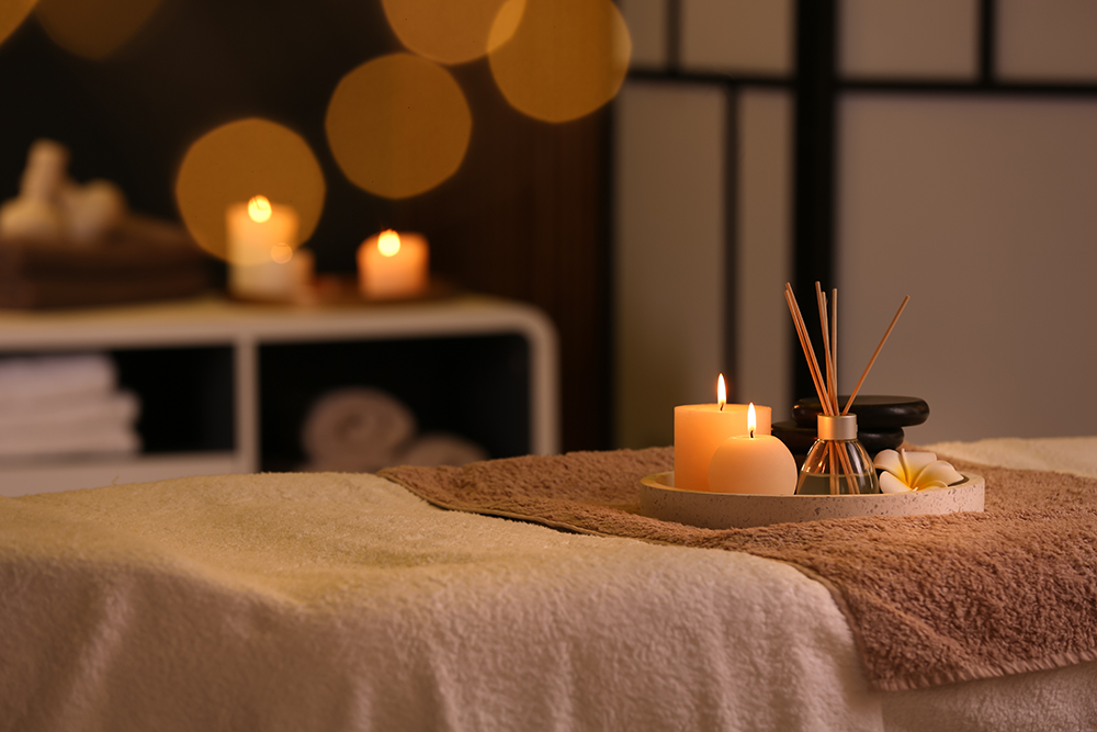 Spa room with massage table and candles