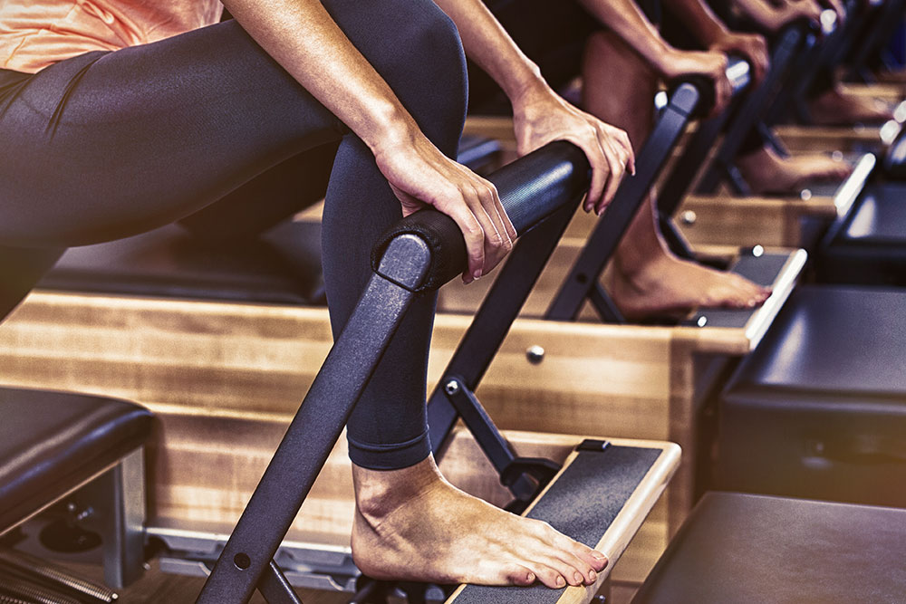 Close up of bars and people doing pilates